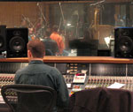 "John recording and live mixing the score to ""Elephant's Egg"" at Capitol studios A+B Maestro Patrick Kirst is seen just above right monitor speaker"